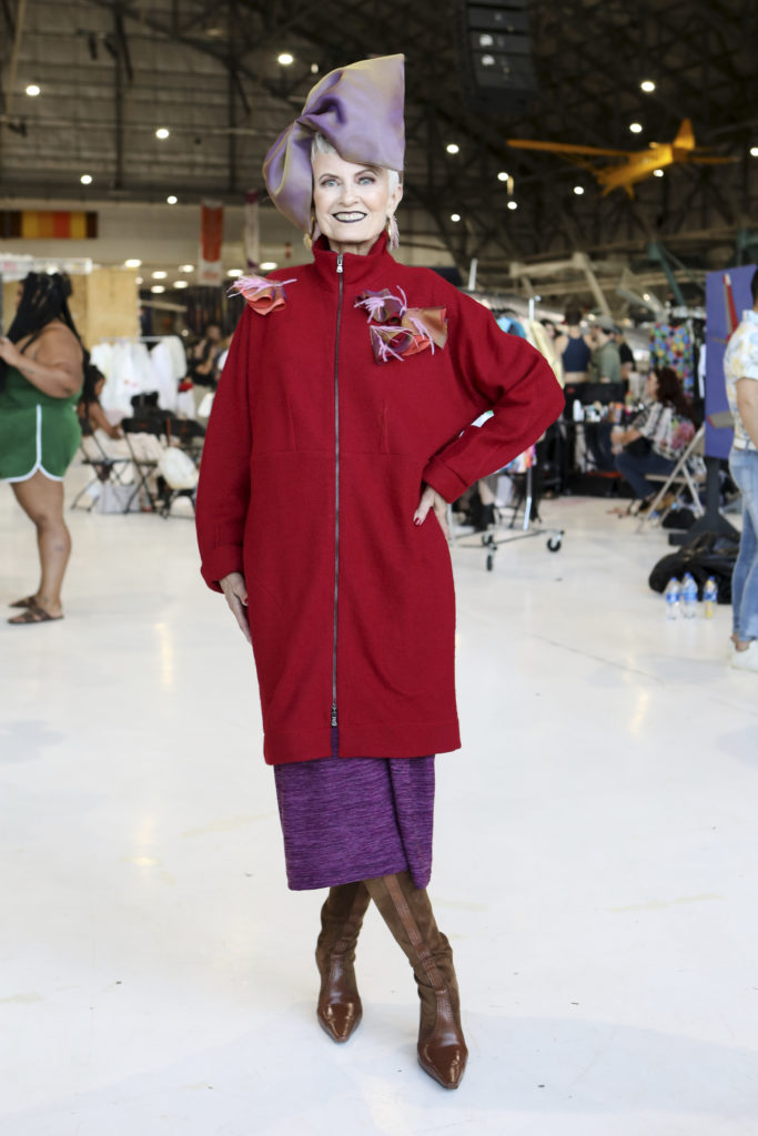 StyleCrone's Judith Boyd in a custom design by Brooks LTD modeled backstage at Latin Fashion Week Colorado