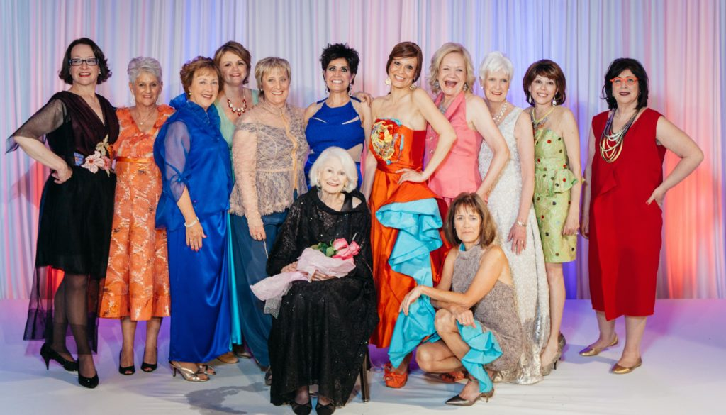 the 2015 Sue Miller Day of Caring runway lineup wearing Brooks LTD