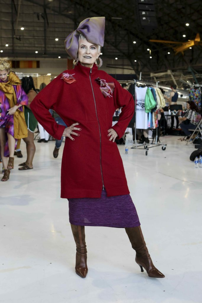 Style Crone's Judith Boyd backstage at Latin Fashion Week Colorado wearing her custom Brooks LTD headpiece, The Judith