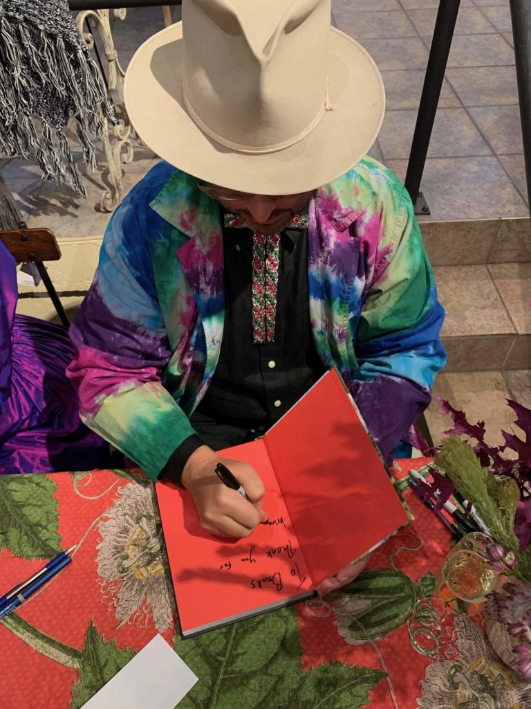 Advanced Style's Ari Seth Cohen signing his latest book, Advanced Love