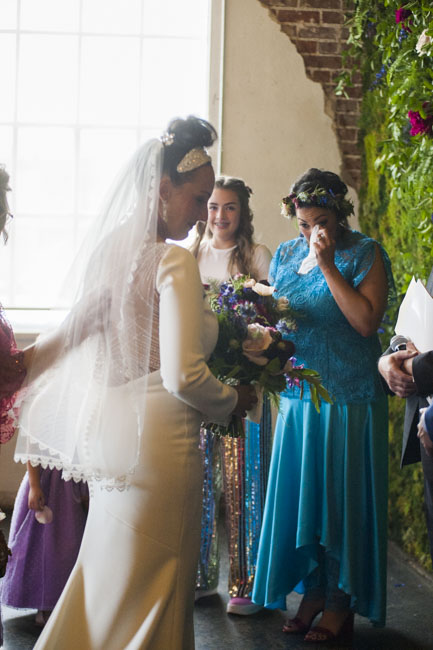 Tears of joy: Twin sister and Maid of Honor Erin gets emotional looking at bride Megan. Both wear custom Brooks LTD.