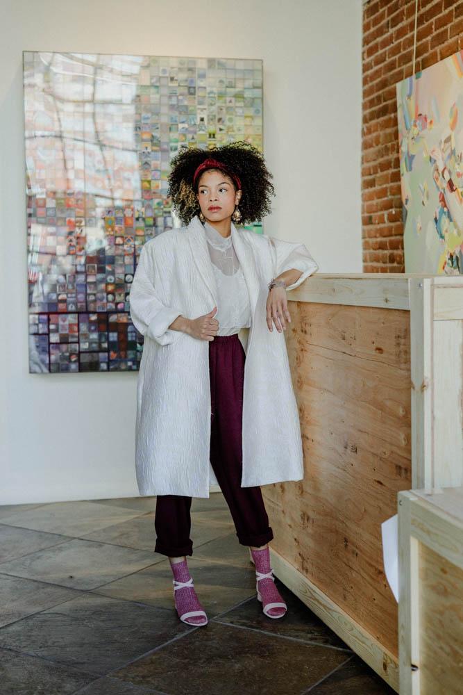 DanShay stands in front of art by Jonathan Saiz