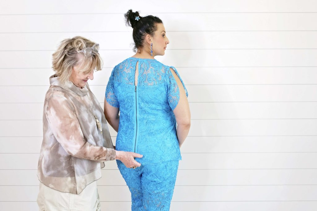 The bride's twin sister wears a convertible turquoise lace look